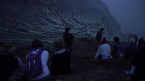 Tourists waiting for sunrise at crater rim of Ijen volcano stock footage