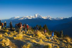 Tourists waiting sunrise at Poonhill, Annapurna circuit in Nepal royalty free stock photo