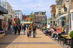 Tourists wakling along the popular shop street in Zandvoort Royalty Free Stock Image