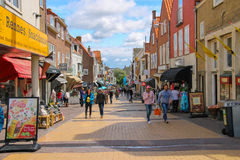 Tourists wakling on the popular shop street Kerkstraat Royalty Free Stock Images