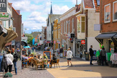 Tourists wakling on the popular shop street Kerkstraat Stock Images