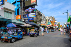 Tourists walk along backpacker haven Khao San Road Royalty Free Stock Photography