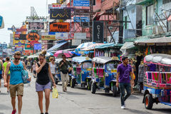 Tourists walk along backpacker haven Khao San Road Stock Photos