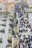 Tourists walk along the Bridge. Tourists walk along the Charles Bridge Royalty Free Stock Photos
