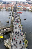 Tourists walk along Bridge. Tourists walk along the Charles Bridge Stock Photos