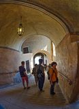 Tourists walk along the corridors of a medieval castle Stock Photos