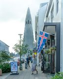 Tourists walk along the main avenue of Reykjavik crowded with shops stock photos