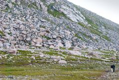 Tourists walk along the rocky slope, island of Mageroya, Norway Royalty Free Stock Photo