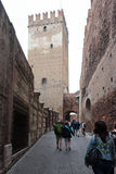 Tourists walk along street leading to Ponte Scaligero in Verona Royalty Free Stock Photos