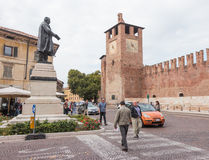 Tourists walk along Via Rome, which leads to Castelvecchio Muse Royalty Free Stock Photo