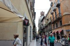 Tourists walk along Via Rosa, inspect and photograph in Verona Stock Photos