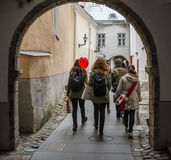 Tourists walk through the ancient streets of Tallinn Stock Photo