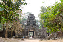 Tourists walk around Angkor hidden in jungle Royalty Free Stock Photography