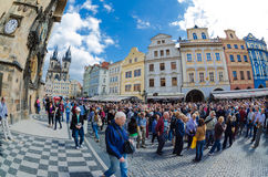 Tourists walk around the Old Town Square in Prague waiting for s Stock Image