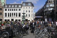 TOURISTS WALK AMONG BIKES Royalty Free Stock Photo