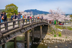 Tourists walk on the bridges of Arashiyama Stock Images