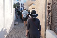 Tourists walk down narrow City walkway royalty free stock photo