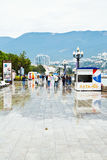 Tourists walk on embankment in Yalta in rain Stock Photography