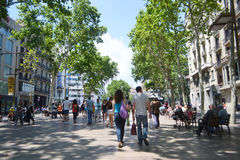 Tourists walk famous Rambla street in Barcelona. Stock Image