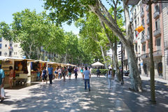 Tourists walk famous Rambla street in Barcelona. Royalty Free Stock Photos