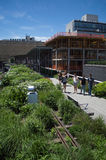 Tourists walk in the High Line Park in New York City Stock Photo