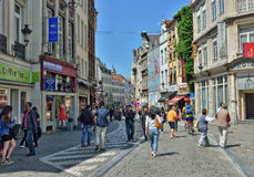Tourists walk in historical center of Brussels Royalty Free Stock Images