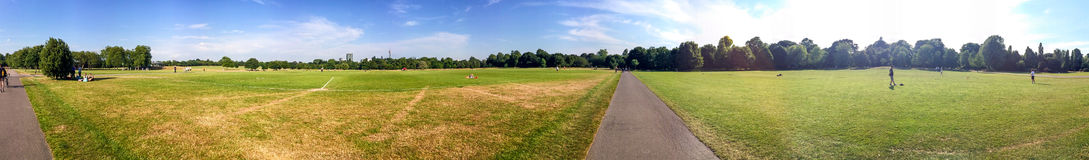 Tourists walk in Hyde Park, panoramic view, London Royalty Free Stock Image