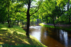 Free Tourists Walk In The City Park In The Summer In Riga Royalty Free Stock Photo - 56689315