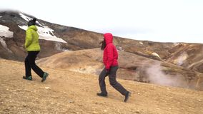 Tourists walk in Kerlingarfjoll geotermal area stock video