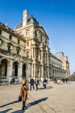 Tourists walk on the Louvre Royalty Free Stock Images