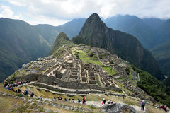 Tourists walk in Machu Picchu site Royalty Free Stock Image