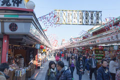Tourists walk on Nakamise Dori in Sensoji shrine. The Nakamise Dori is a street with food and souvenirs shops in Senso-ji shrine, Royalty Free Stock Photos