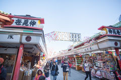Tourists walk on Nakamise Dori in Sensoji shrine. The Nakamise Dori is a street with food and souvenirs shops in Senso-ji shrine, Stock Photography