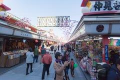 Tourists walk on Nakamise Dori in Sensoji shrine. The Nakamise Dori is a street with food and souvenirs shops in Senso-ji shrine, Royalty Free Stock Image