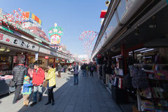 Tourists walk on Nakamise Dori in Sensoji shrine. The Nakamise Dori is a street with food and souvenirs shops in Senso-ji shrine, Stock Photos