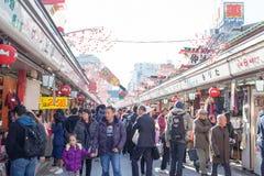 Tourists walk on Nakamise Dori in Sensoji shrine. The Nakamise Dori is a street with food and souvenirs shops in Senso-ji shrine, Royalty Free Stock Photo