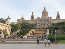 Tourists walk from the National Museum of Art of Catalonia Royalty Free Stock Photo