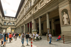 Tourists walk next to the famous Uffizi Gallery in Florence, Ita Stock Photo