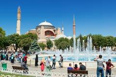Tourists walk next to Hagia Sophia in Istanbul, Turkey Royalty Free Stock Image