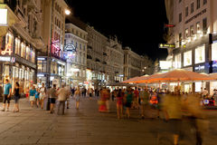 Tourists walk at night in center of Vienna, Austria Royalty Free Stock Photos