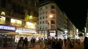 Tourists walk at night in center of Vienna, Austria stock video footage