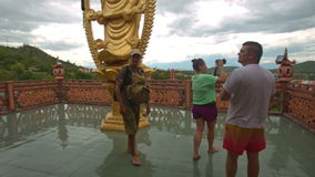 Tourists Walk out to Observation Plot in Buddhist Temple stock video