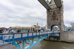 Tourists walk over Tower Bridge in London, UK stock photo
