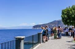 Tourists walk in the park Villa Comunale in Sorrento. Italy stock photo