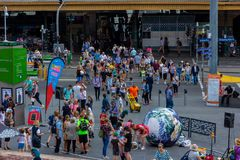Tourists walk pass Melbourne Visitor Centre at Federation Square. stock image