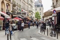Tourists walk past a cafeteria and souvenir store - Paris, Franc Stock Photos