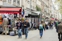 Tourists walk past a cafeteria and souvenir store - Paris, Franc Royalty Free Stock Photos