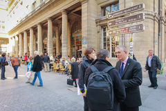 Tourists walk past a cafeteria and souvenir store in Paris.JPG Royalty Free Stock Image