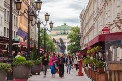 Tourists walk on pedestrian street in center of St. Petersburg Stock Photos