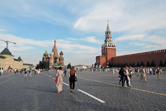 Tourists walk on the Red Square in Moscow. Stock Photos